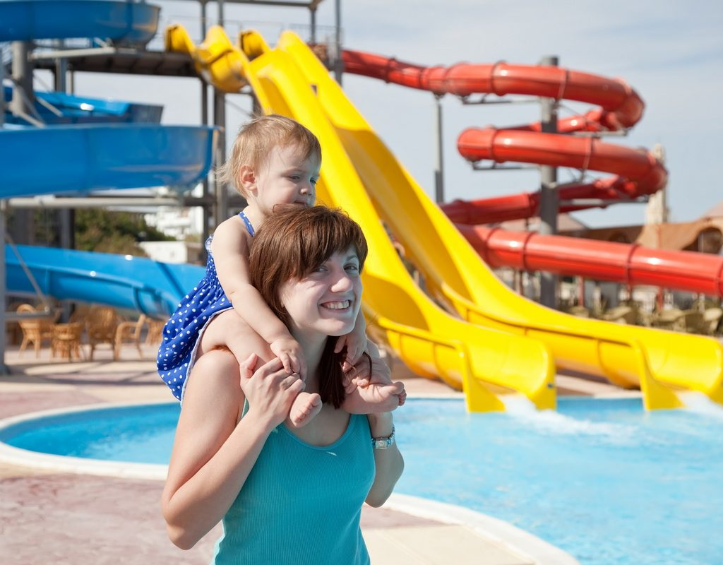 happy mother with toddler at aquapark