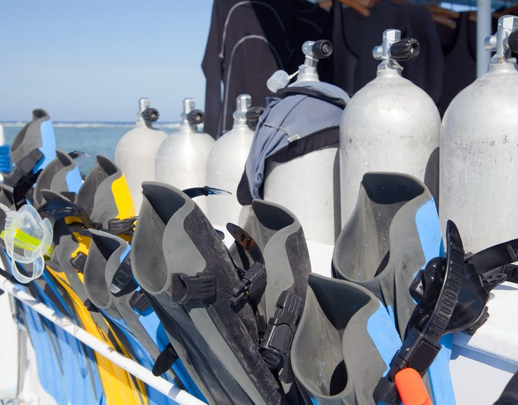 Diving equipment positioned on a deck of a boat
