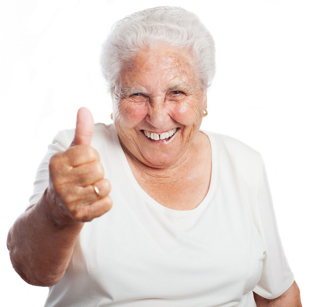 old woman thumb up on a white background