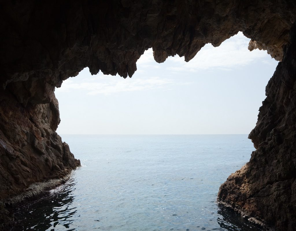 Inside view of cave in cliff. Nature composition